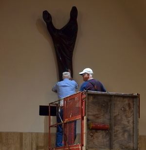 Bill Hafemeister & Tom Cofojohn reinstall Risen Christ after church renovations